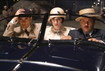 """(L-r) TOBEY MAGUIRE as Nick Carraway, ELIZABETH DEBICKI as Jordan Baker and JOEL EDGERTON as Tom Buchanan in Warner Bros. Pictures' and Village Roadshow Pictures' drama """"THE GREAT GATSBY,"""" a Warner Bros. Pictures release."""